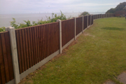 boarded fencing with concrete posts and gravel boards - thumb