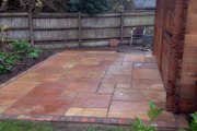 Natural sandstone sunset buff with Woburn rumbled Autumn blocks around the sides