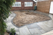 This patio constructed using Natural Sandstone Silver Grey with Graphite edging blocks-thumb